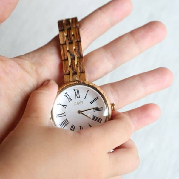 wooden watch with mom and child hands