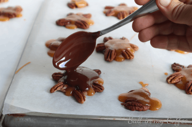 pouring chocolate for paleo maple caramel pecan turtles