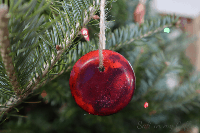 shiny red ornaments from broken crayons
