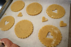 cutting out linzer cookies
