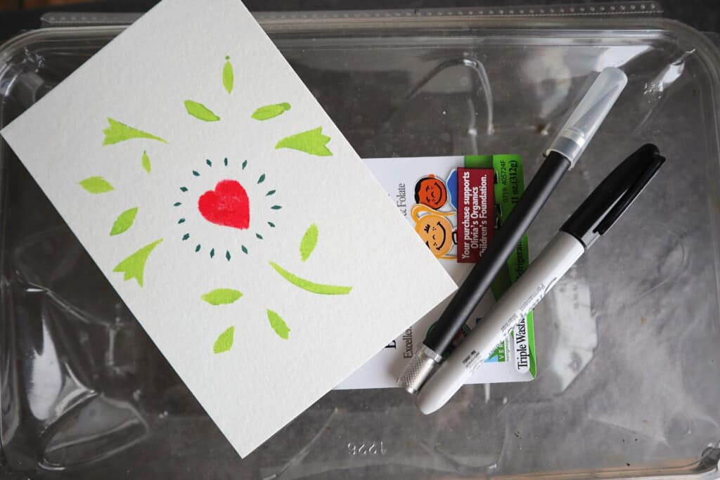 How to make a stencils out of old plastic produce tubs