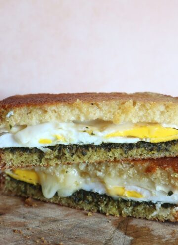panini with duck egg, pesto, and brie
