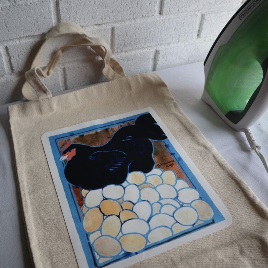 Putting a vintage advertising poster image onto a tote bag, using photo transfer paper and an iron