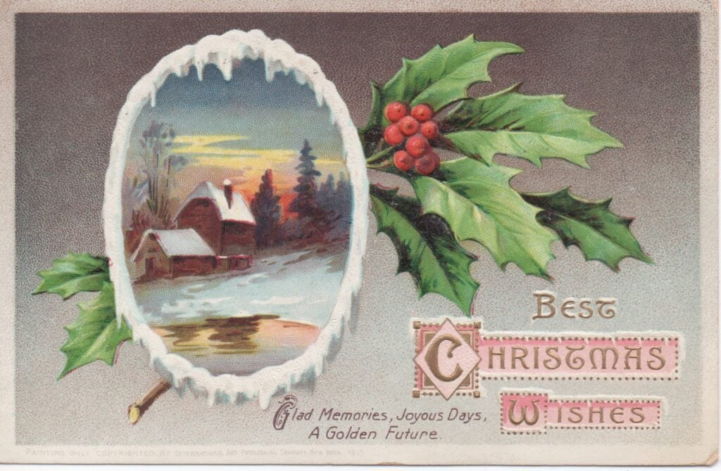 Vintage Christmas postcard with holly and snowy scene